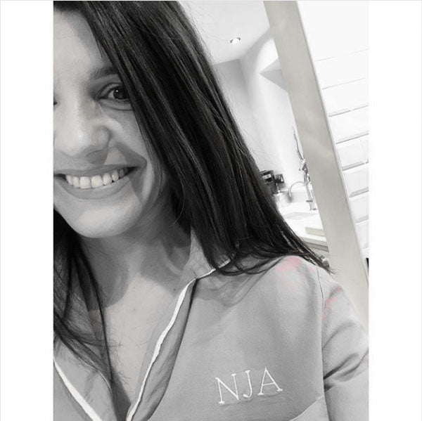 A satisfied client wearing a Look And Cover Pyjama with her Initials on it