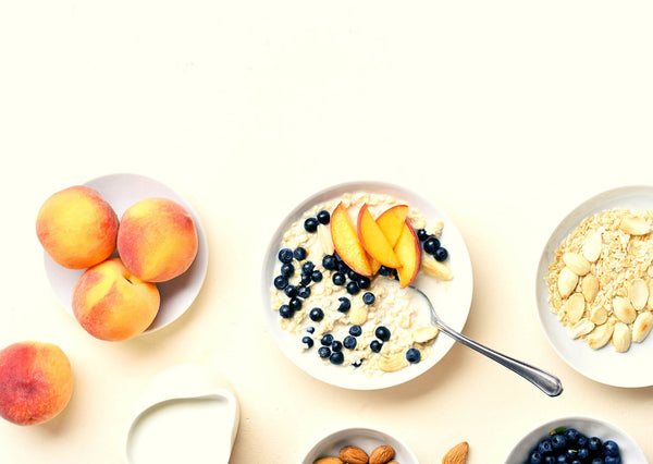 apricot blueberries oats in white bowl