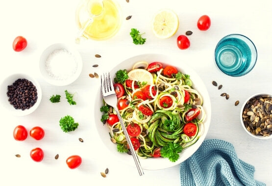 zucchini noodles with tomatoes pumpkin seeds