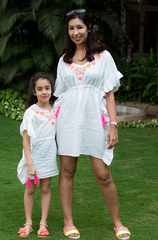 White kids kaftan with neon embroidery, tie waist and neon tassels