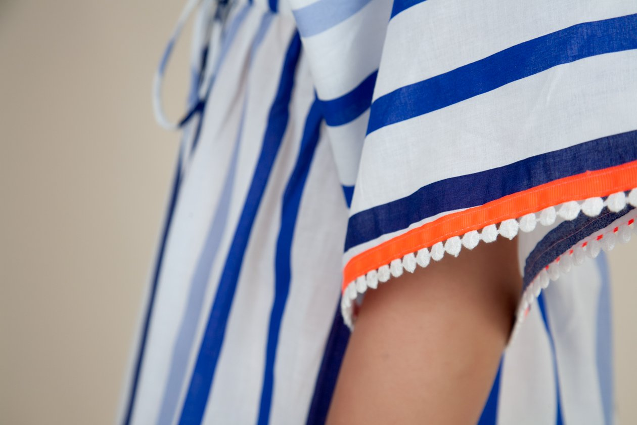Blue and White Stripe cover up with neon trim and crochet detail - sleeve