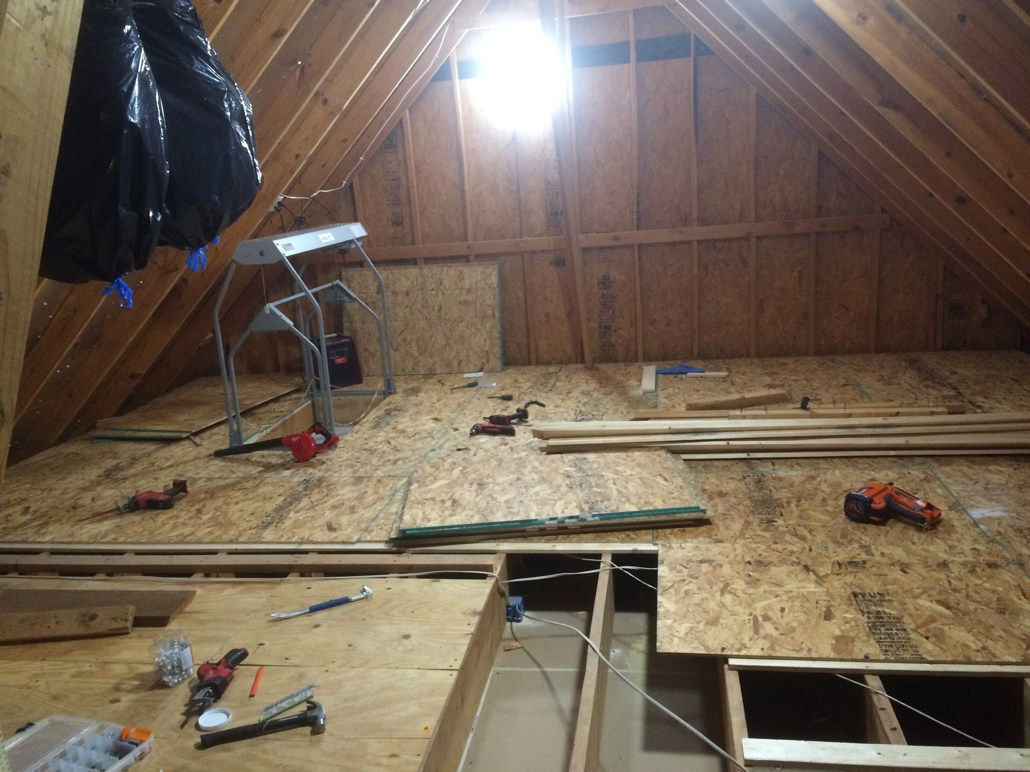 attic with decking being installed