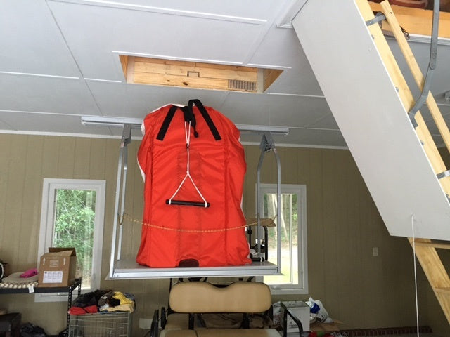 attic lift with luggage on it