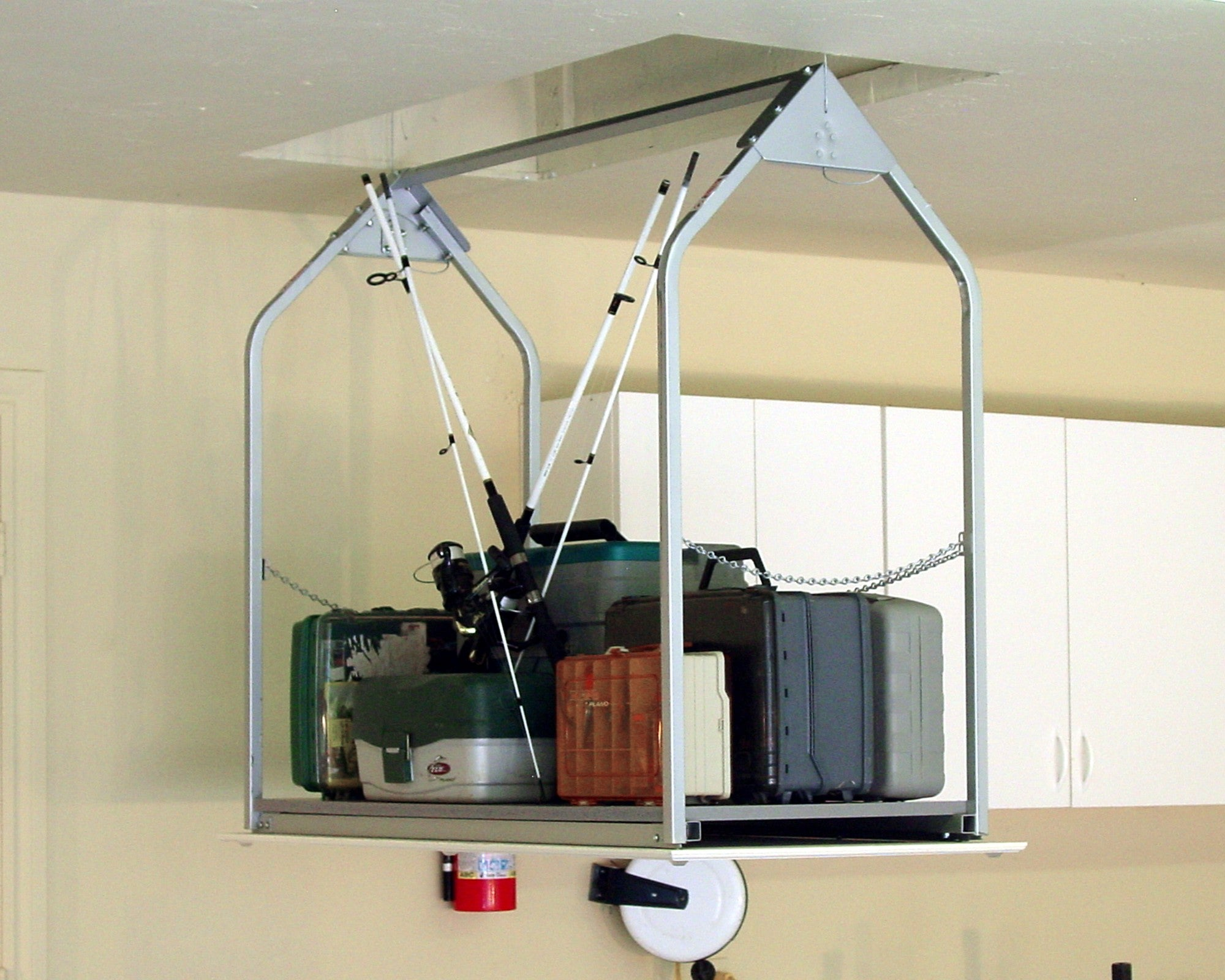 attic lift with fishing equipment