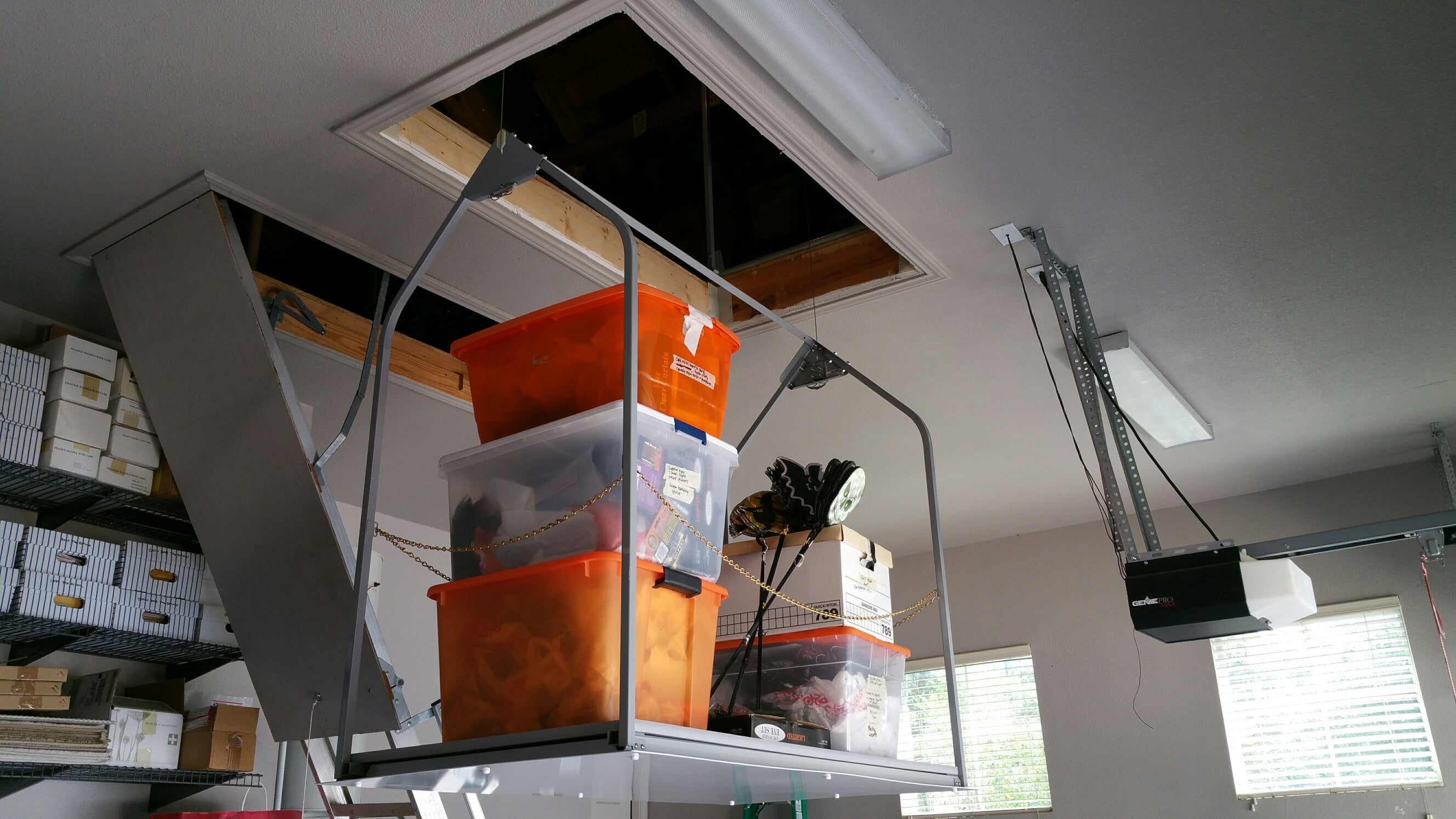 attic lift with orange containers