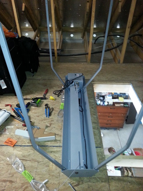 partially assembled attic lift