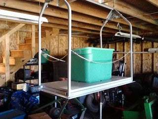 attic lift with green tub