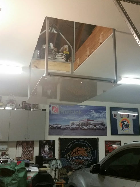 attic lift in nice garage