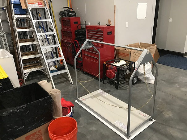attic lift beside tool box