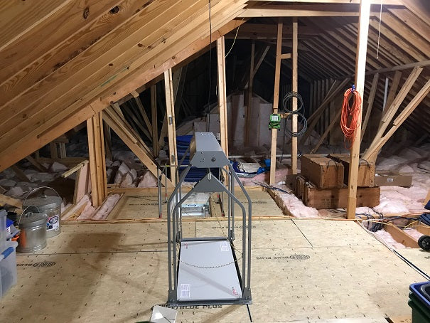 attic lift in messy garage