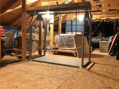 attic lift with stuff on it