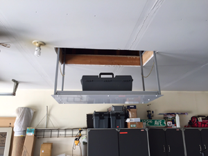 attic elevator with tool box