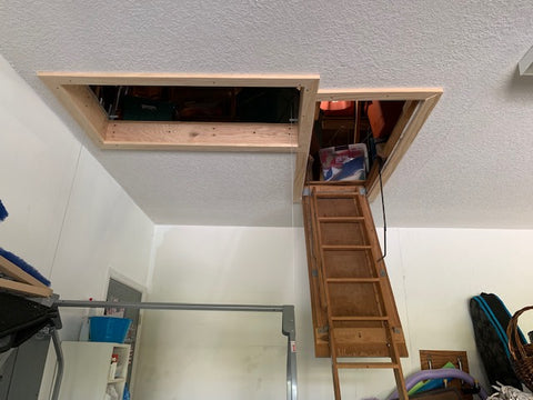 Attic Stairs and attic lift holes side by side garage view FL