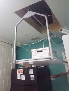 attic lift with box of papers