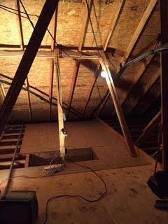 attic structure with garage hoist