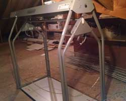 versalift attic lift with carrier