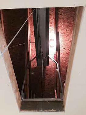 view of attic lift from downstairs
