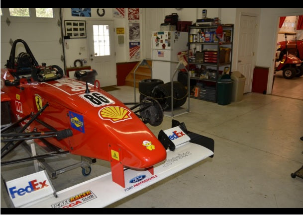formula one race car in organized garage