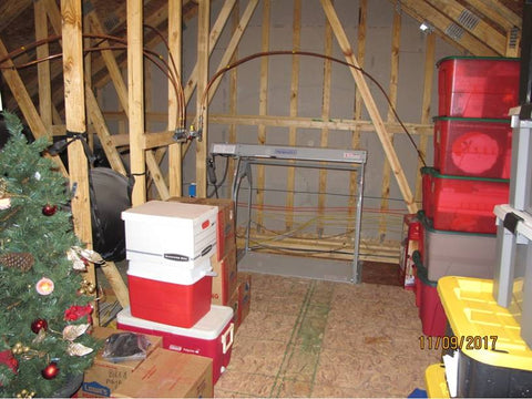 Installed VersaLift in the Attic with Christmas Decorations stored