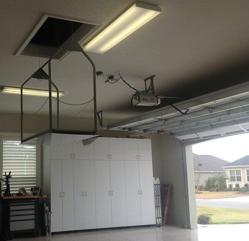 attic lift in white garage