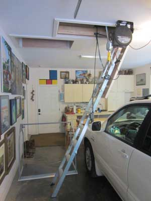 aluminum attic ladder in down position