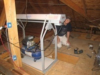 image of man installing attic lift