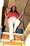 VERSA RAIL MODEL 60 ATTIC LADDER SAFETY RAIL with girl going down