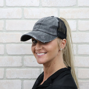 distressed black ponytail cap girl