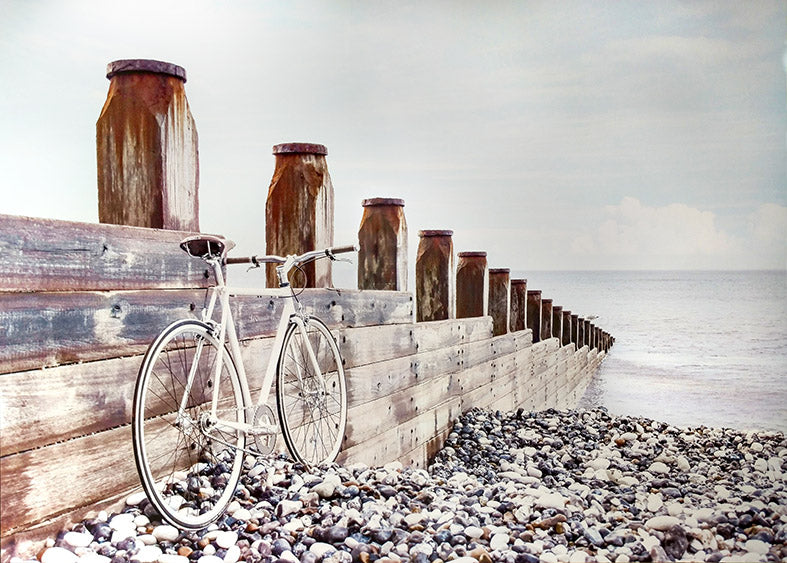 Framed Print of Bicycle in Beach