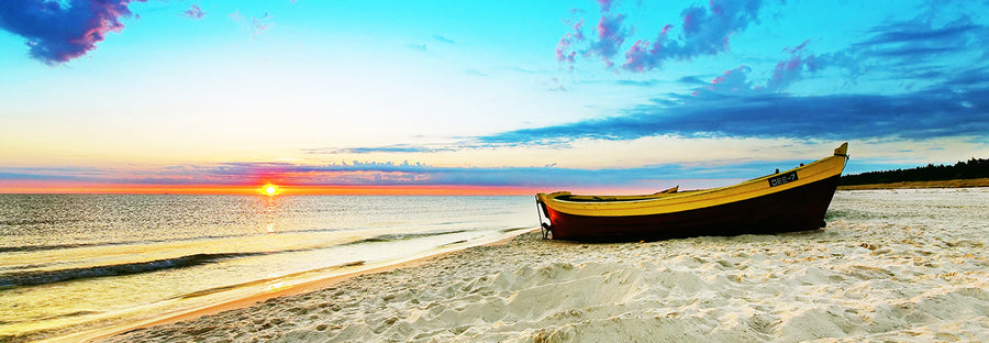 Canvas or Paper Print of Boat on Beach with Sunrise