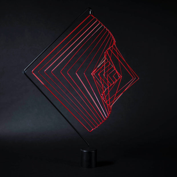 Square Wave Coral Red on a stand