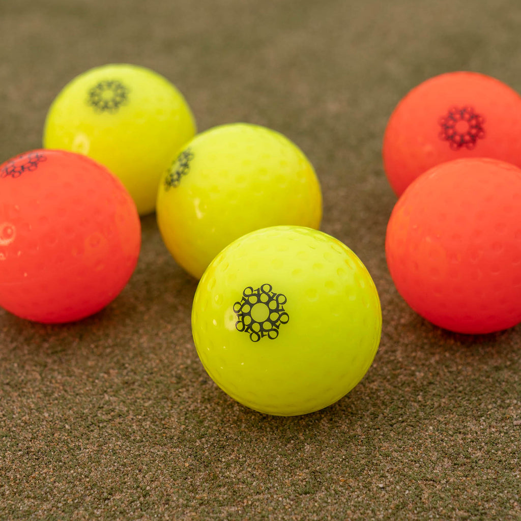 Eighteen branded match quality hockey balls