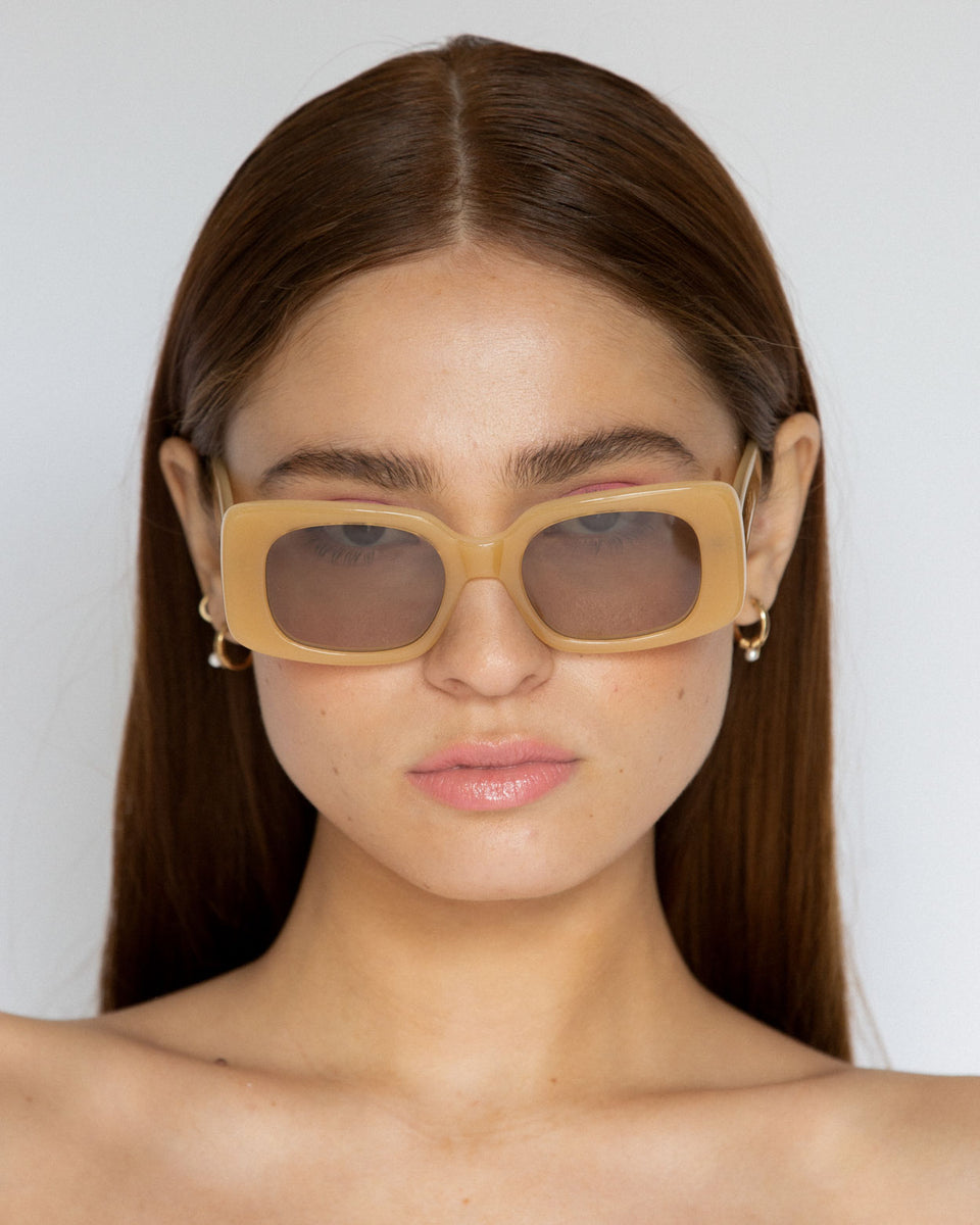 Lu Goldie Coco square Sunglasses in yellow acetate with tan brown lenses, on model