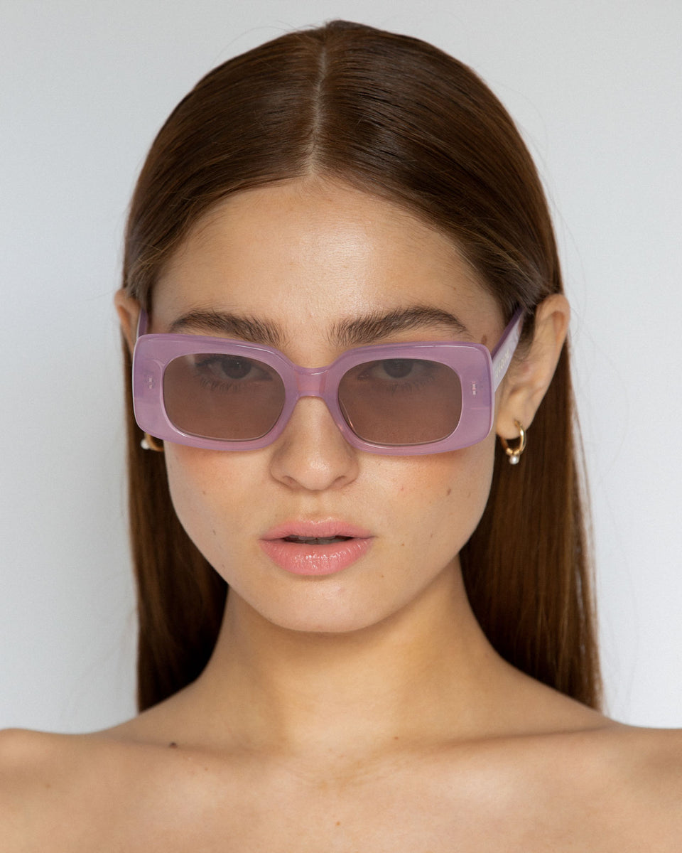 Lu Goldie Coco square Sunglasses in lilac purple acetate with tan brown lenses, on model
