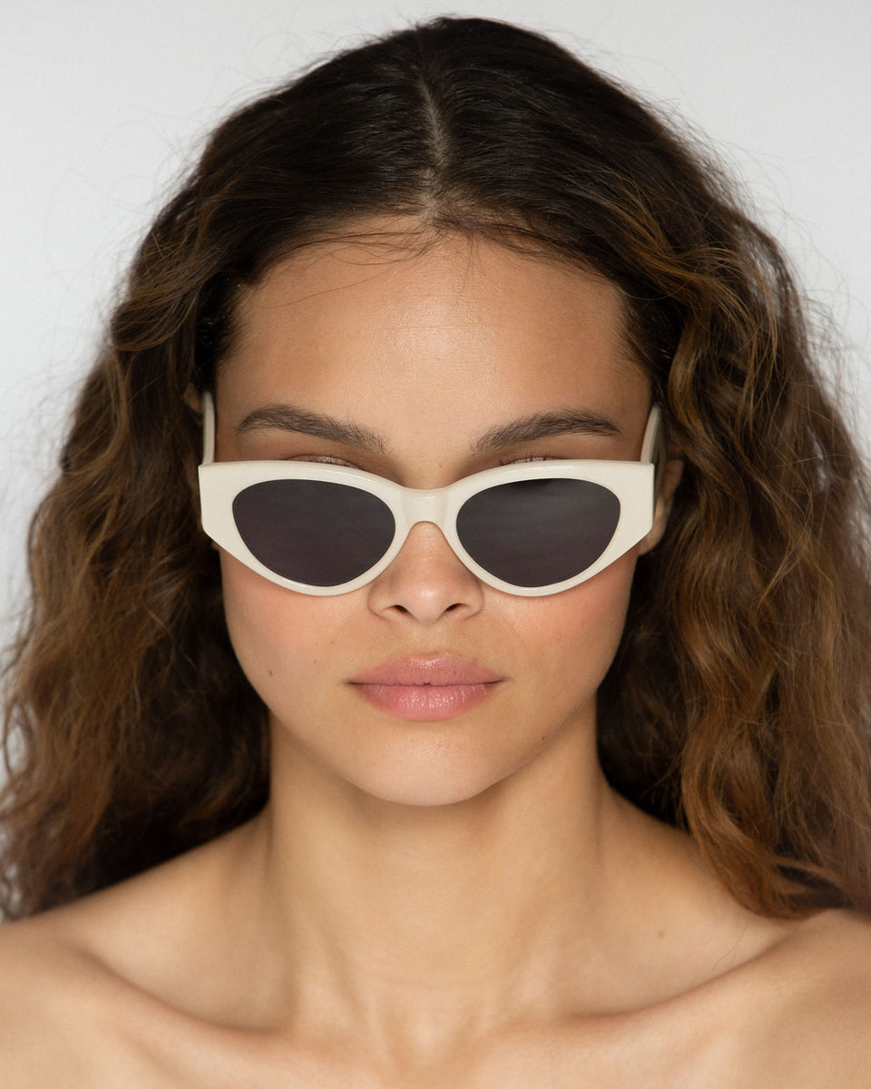 Lu Goldie Giselle oversize Sunglasses in white cream acetate with black lenses, on model