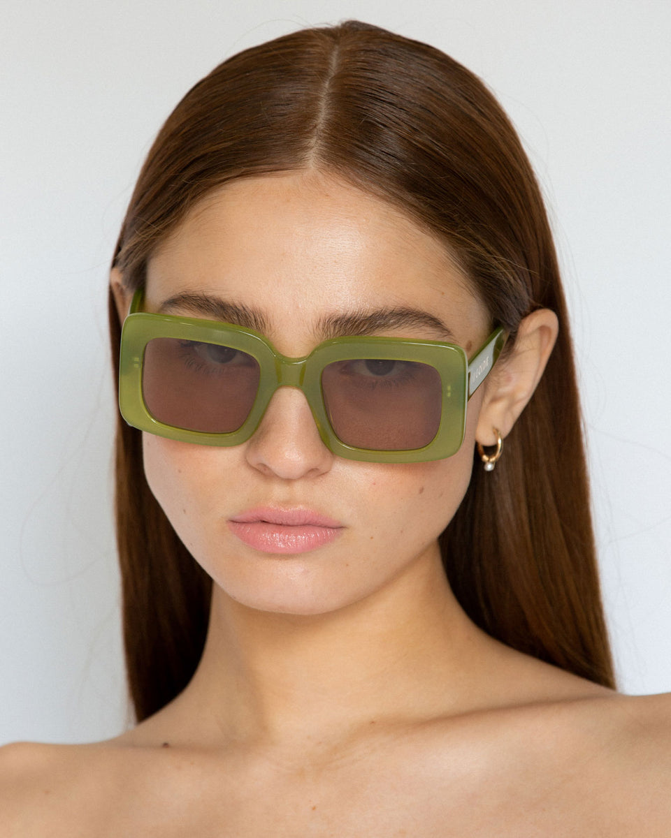 Lu Goldie Mia oversize square Sunglasses in leaf green acetate with tan brown lenses, on model