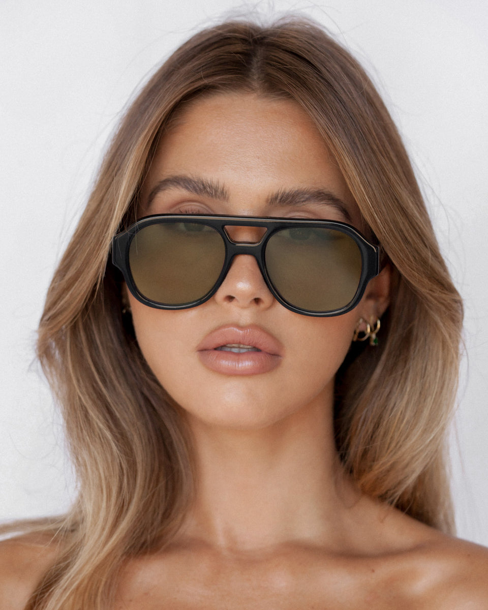 Ruby Tuesday Matthews wearing the collaboration sunglasses in Black and Olive lens 2
