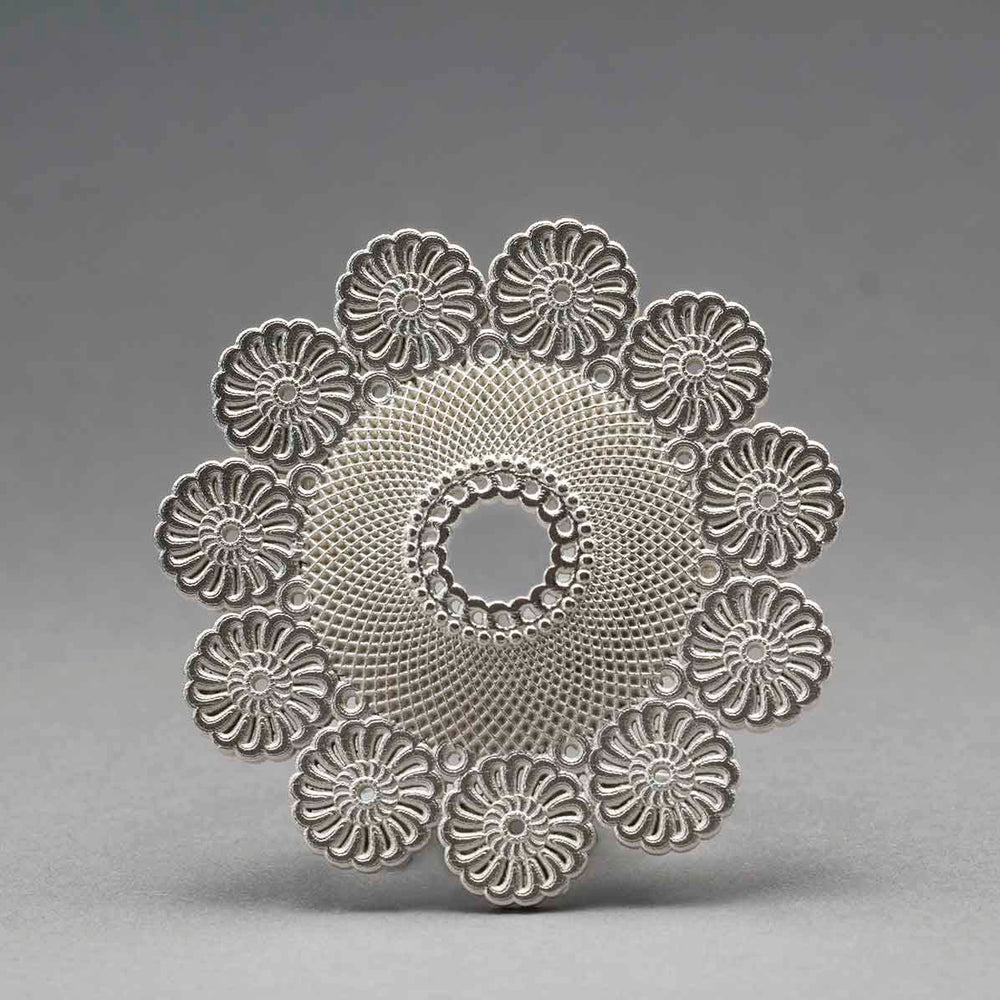 Lace Star - Rigel. | Materials: 925 Silver. | Dimensions 45mm x 45mm x 10mm. | Year 2011. | Photographer: Rod Buchholz