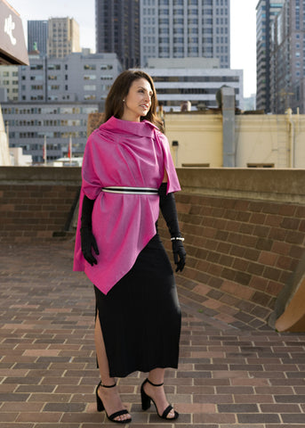 Model wearing UV sun protection sol Escape in berry pink, asymmetrical and belted