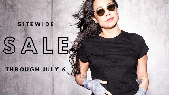 "getHeliGirl wearing sun protective hand gloves in Denim and sign says ""Sitewide Sale Now Through July 6th"""