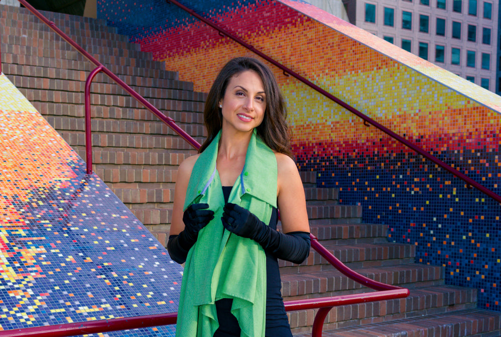 Model wearing UV sun protection sol Escape in apple green like a scarf with black strapless evening gown