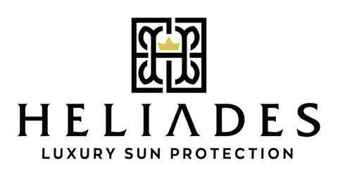HELIADES Luxury Sun Protection logo with stylized 'H' and crown in center