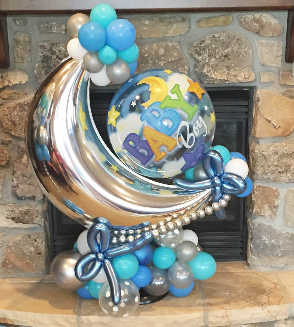 This balloon centerpiece is available in pink or blue, it stands about 3' tall.