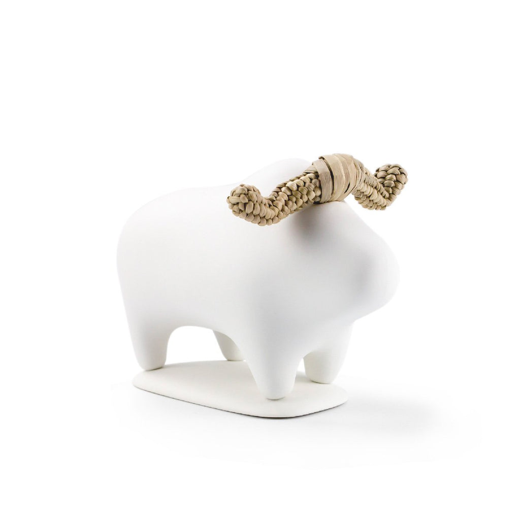 White playful buffalo animal decor that brings joy to your interiors
