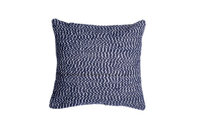 Blue and white textured throw pillow