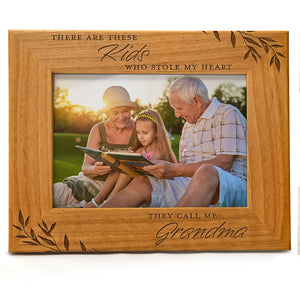 There are these kids who stole my heart, they call me Grandma. | Engraved Natural Wood Photo Frame | Fits 5x7 Horizontal Portrait