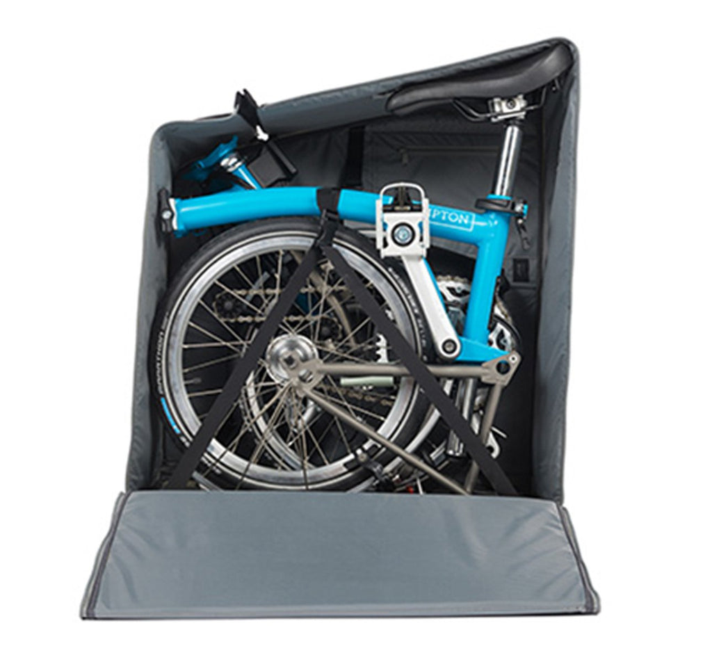 Brompton Padded Travel Bag with Four Rollers Shown Open with a Brompton Bike
