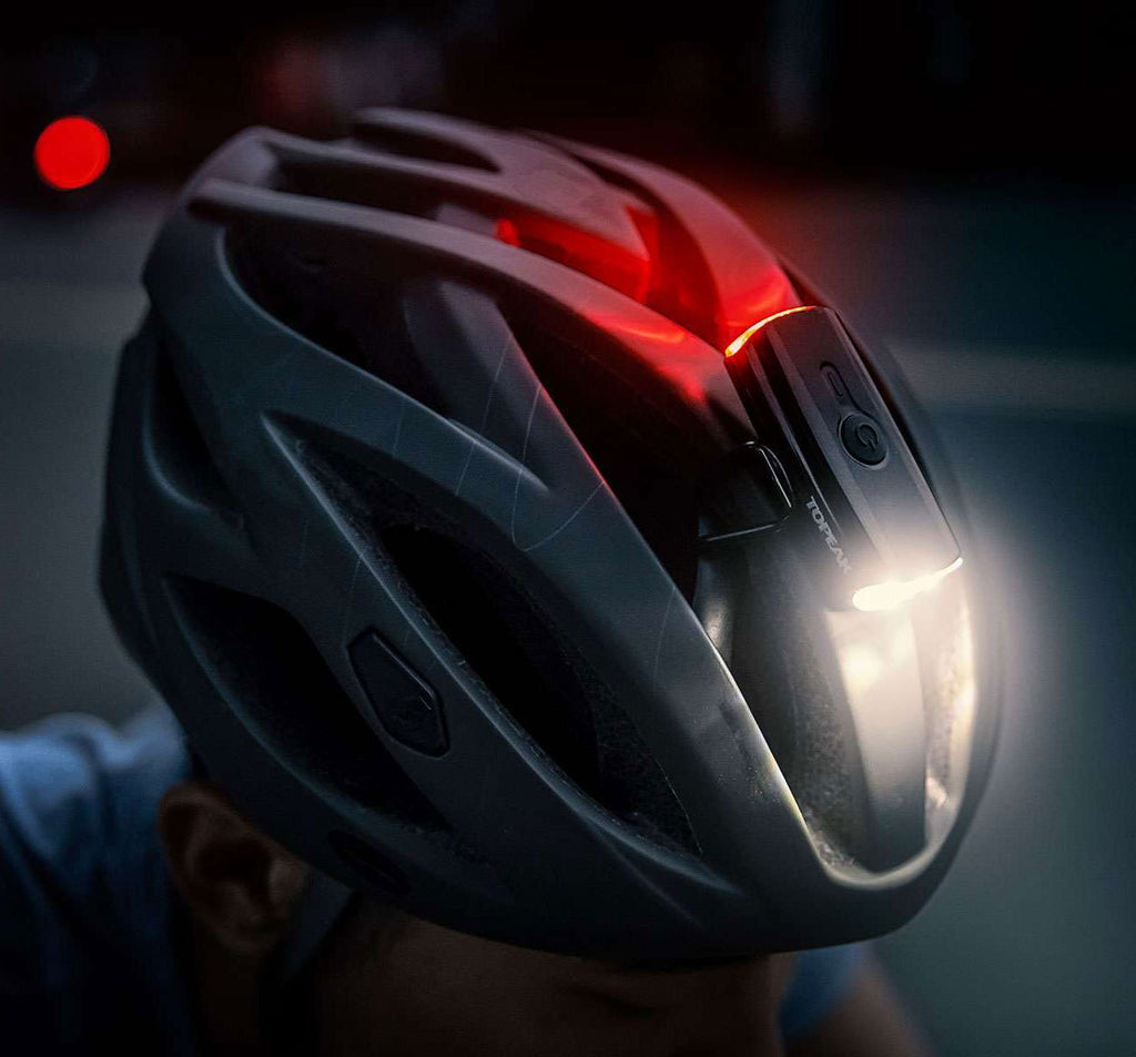 Topeak Headlux Dual USB Bicycle Light On Helmet Worn By Rider