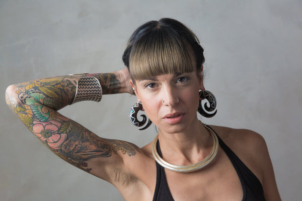 Woman wearing organic ear stretchers for large stretched lobes by Tribalik