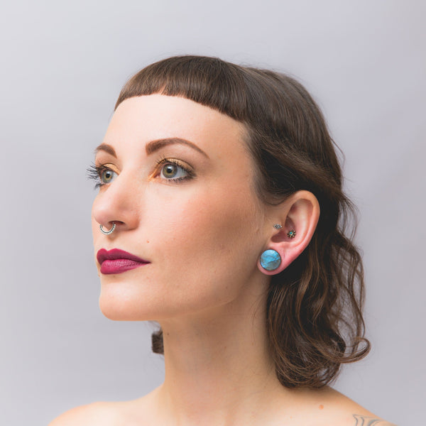 Woman wearing Tribalik Ear Plug Jewellery for Stretched Ear Lobes